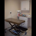 An exam room with pneumatic table scale.